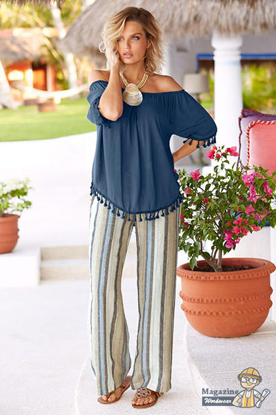 A perfect outfit with a fringed off-shoulder top and blue striped linen pants